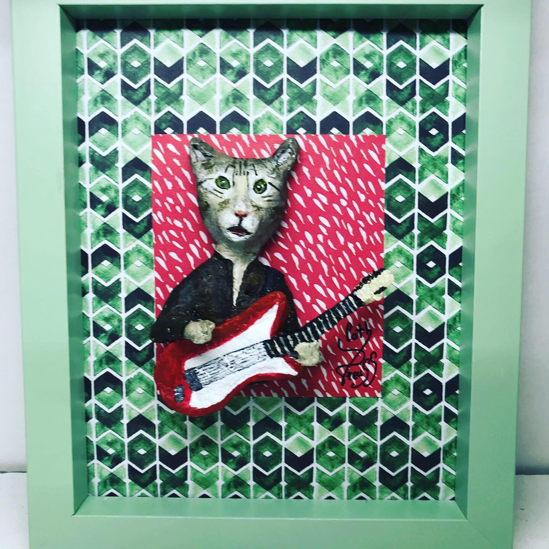 Le chat guitariste